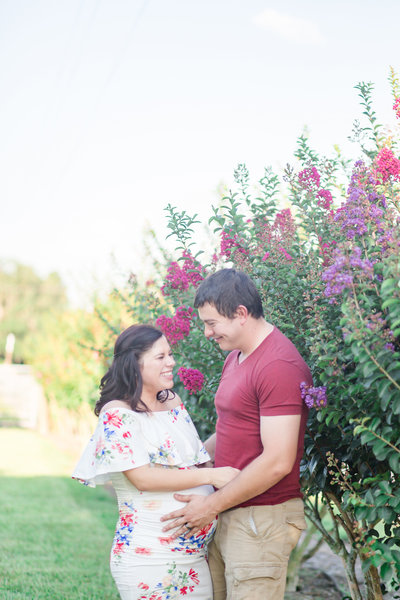 Parents to be giggle during maternity session in Wauchula, FL.