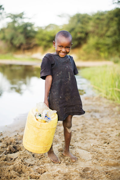 Girl in Kenya getting water