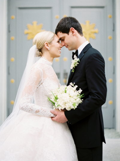 Bride and Groom lace wedding dress and lily of the valley bouquet