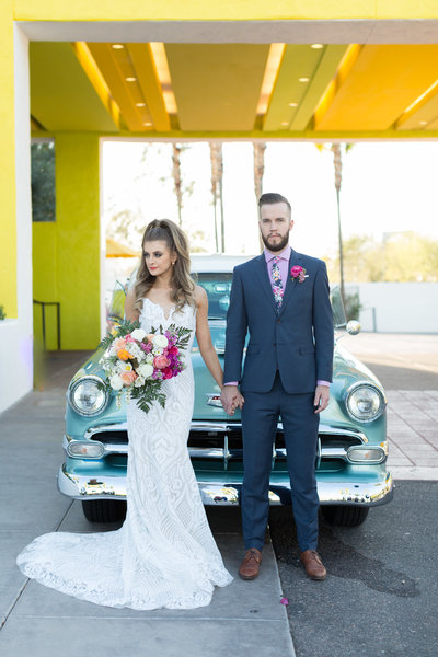 bride and groom colorful vintage car