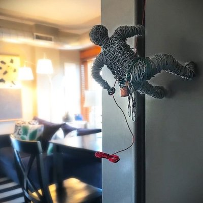 Rock climbers are sure to love this souvenir of a tiny climber rappelling down the appliances at Lafayette Flats.