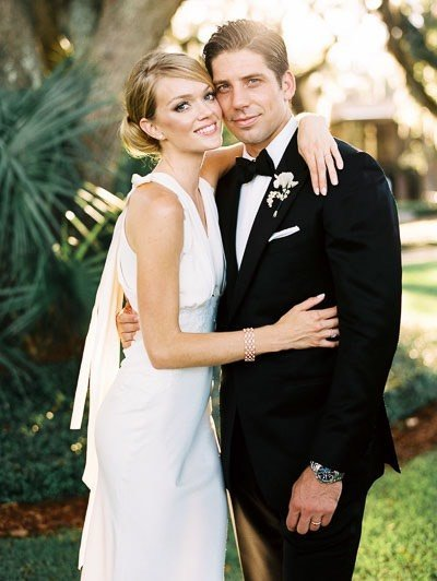 Lindsey Ellingson, Victoria's Secret model, in wedding gown with husband
