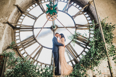 M Harris Studio - Bride and Groom in front of large clock