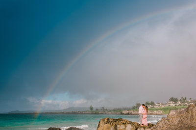 A rainbow appears to celebrate the babymoon of this sweet couple for their maui photos.