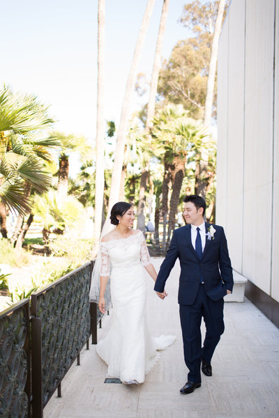 Bride and Groom walking in Balboa Park before their wedding at the Museum of Photographic Arts San Diego Venue