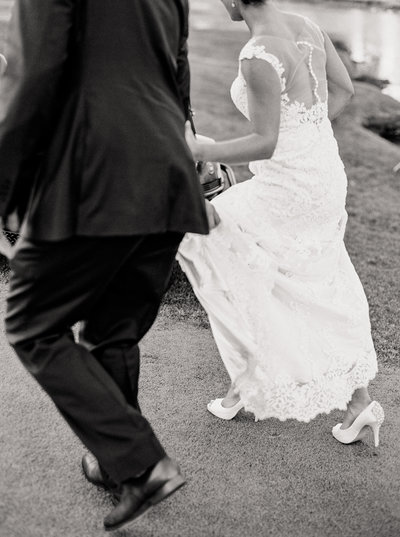 black and white film of couple running together by Natalie Jayne Photography