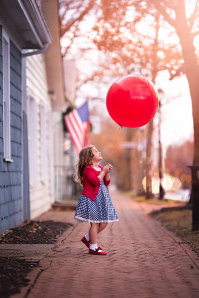 photo of a girl and red balloon dublin ohio