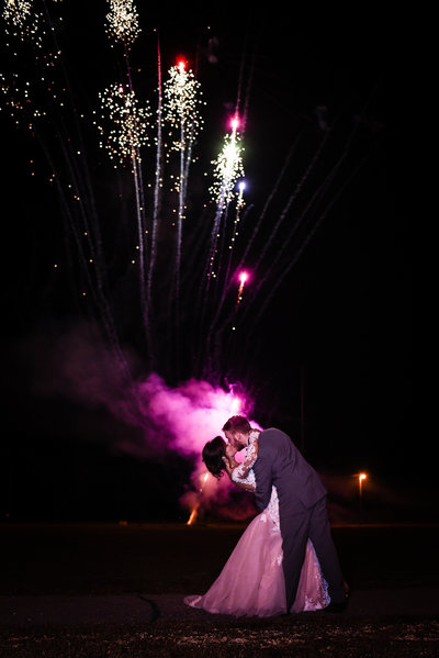 Couple kisses in front of fireworks, New Years Eve Wedding,  Mississippi Wedding