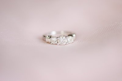 Three stone engagement ring with platinum wedding band
