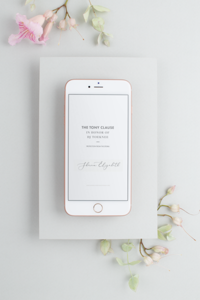 mockup-of-an-iphone-on-a-matte-white-cardboard-environment-with-flowers-22136