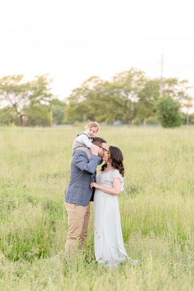 Dylan & Sandra kiss in a field located in London Ontario