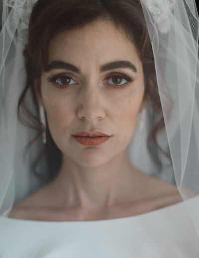 bride in veil and make-up