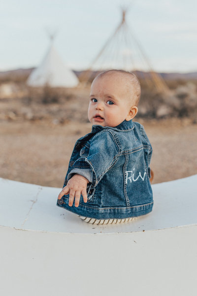 baby wearing embroidered jean jacket