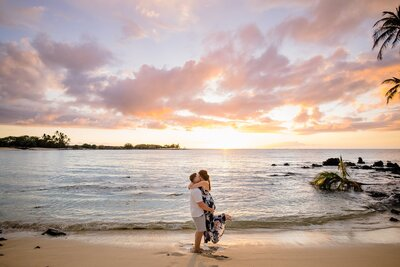 couple kissing on hawaii beach at sunset