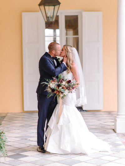 Winter Bride and Groom Kiss at William Aiken House Wedding