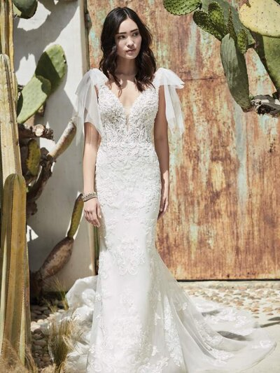 Low Back Fit-and-Flare Wedding Dress. Chic and exquisite (yet perfectly un-stuffy), this unique low back fit-and-flare wedding dress appeases your boho heart while elevating your effortless style.