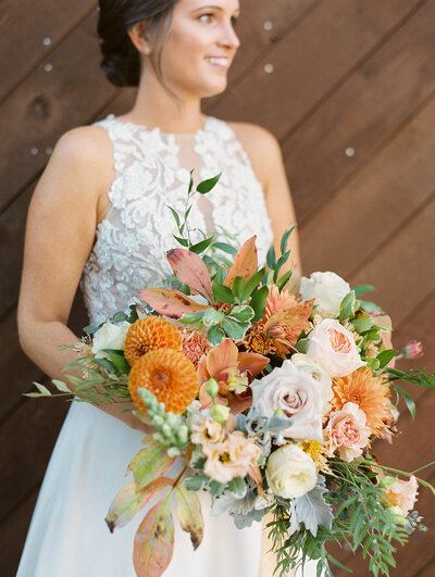 bride looking off into the distance with wedding bouquet in hand