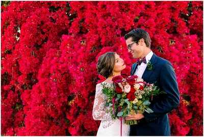 Bride and groom infront of flowers | Orlando Wedding Photographer