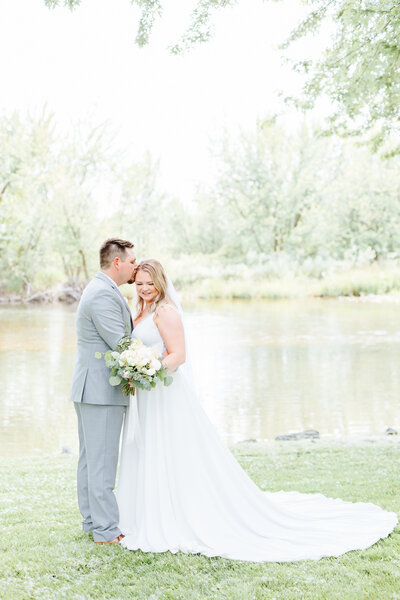 Bride and Groom by the Boise River at White Willow Estate Wedding