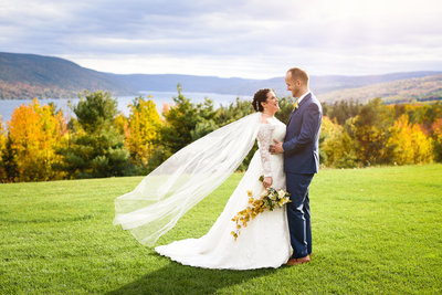 Couple lakeside at upstate  New York Bristol Harbour wedding in wine country