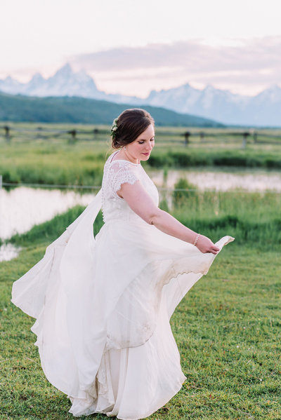 bride twirling skirt ranch wedding in jackson hole