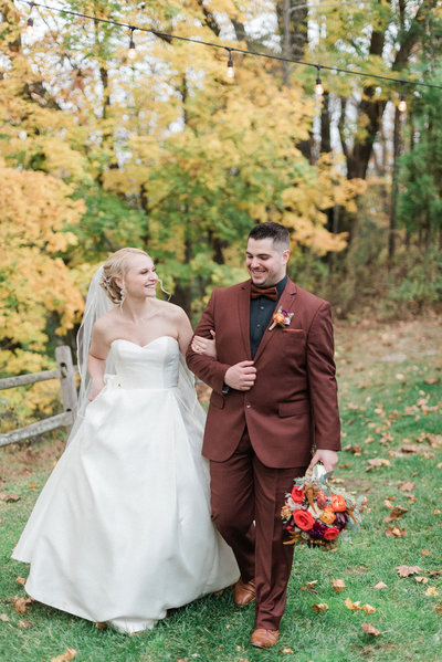 Bride and groom walk hand in hand at their NJ wedding