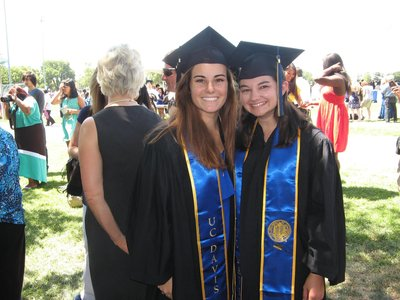 Amber and friend in graduation gown at UC Davis