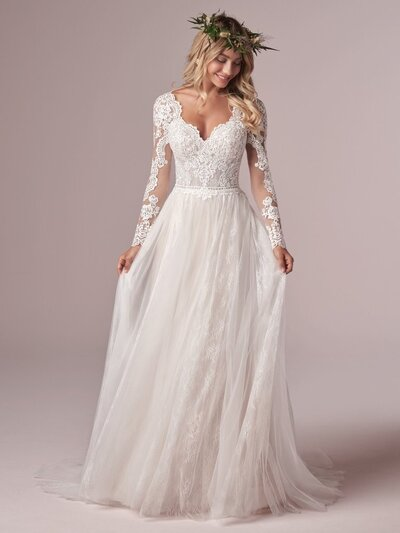 Long Sleeve Boho Lace Wedding Dress. Ok, so you're not required to wear a flower crown with your long-sleeve boho lace wedding dress, but would you agree it looks super magical this way?