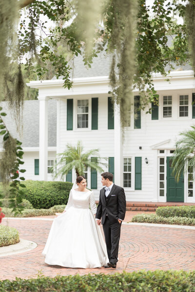 Married couple walking together at cypress grove estate