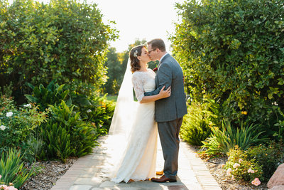 Bride and Groom kissing on a pathway at Gerry Ranch in California