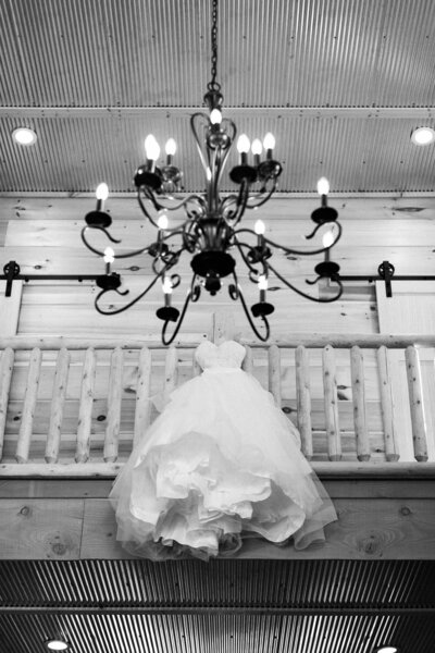 wedding dress hanging from rail