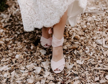 Lake Tahoe Wedding Planners bride walking in blush velvet shoes,  wedding at venue Mitchell's Mountain Meadows Sierraville near Truckee, Joy of Life Events image by The Shepards Photo