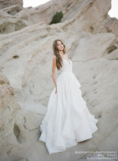 Hayley Paige bridal gown - Ivory geometric organza A-line gown, draped bodice with plunging sweetheart neckline and illusion net insert, asymmetrical cascading skirt over cashmere lining.