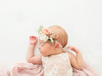 Newborn baby girl photographed by Halleigh Hill