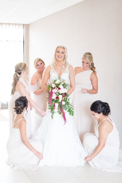 Bride gets ready with bridesmaids.