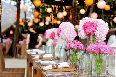 pink flowers on a large oak table