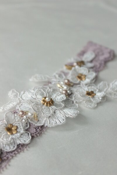 Custom garter dusty mauve with lace applique beading and gold elements 7