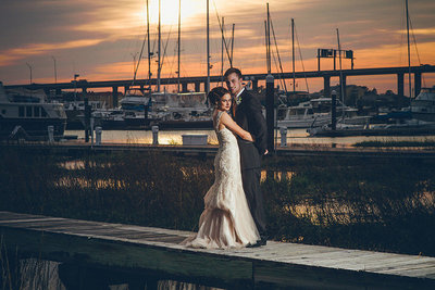 bride and groom on docks at the rice mill