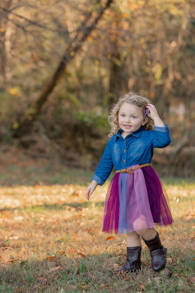 Portrait of a young girl during family photography session at Blackbird Creek Reserve in Townsend, Delaware.