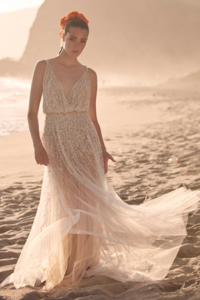 Lead the way in Celestial. This gown's v-neck blouson bodice and custom, light-catching beading has a way of bringing out your inner goddess.