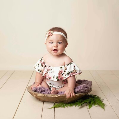 milestone baby sitter session flower outfit with headband in studio