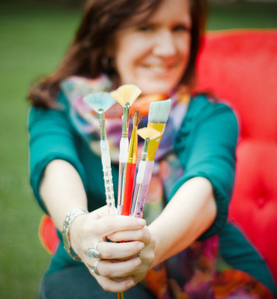 michele holding paintbrushes