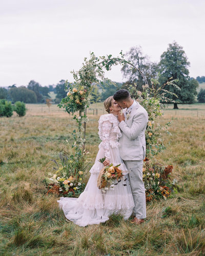 Bride and Groom - Wedding Ceremony with Floral Arch