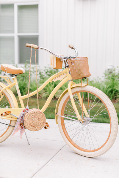 Yellow bicycle with vintage purse