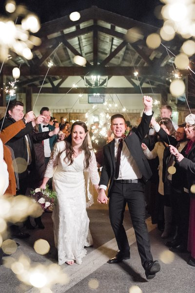 bride and groom celebrate during sparkler sendoff at gardner village