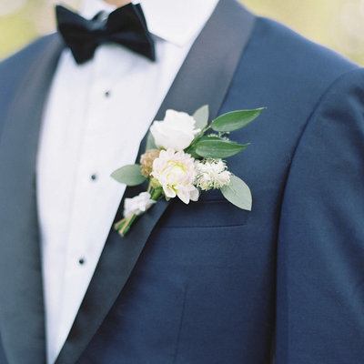 Maine Groom In Navy Suit with Simple White Boutineer