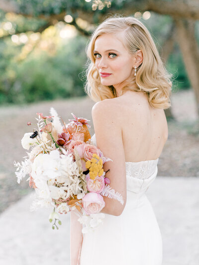 bride looking over shoulder with romantic florals