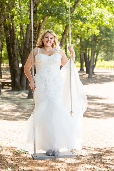 bride on swing, bridal portrait, wine country wedding