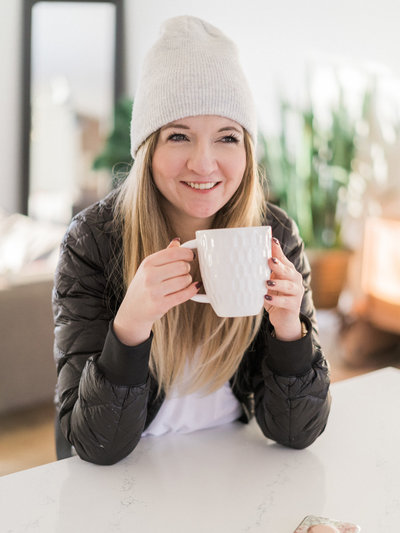 Woman in toque drinking coffee