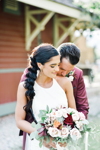Modern bride with burgundy details and a fishtail hair at steam whistle brewery